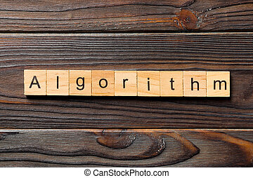 Algorithm word written on wood block. Algorithm text on wooden table for your desing, Top view concept