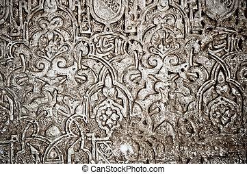 Alhambra in Granada, Andalucia, Spain. Arabesque detail.