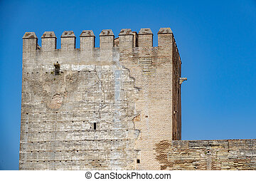 Alhambra tower against blue sky