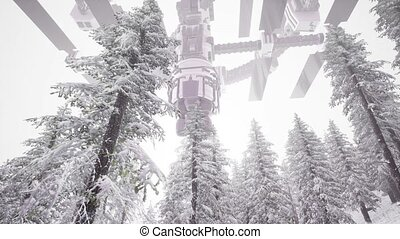 Alien UFO at Earth in mountains with pines and snow