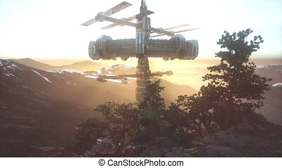 Alien UFO at Earth in mountains at sunset