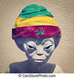 Alien wearing a marijuana cap with retro effect