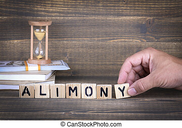 alimony. wooden letters on the office desk
