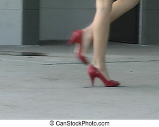 Perfectly toned pair of female legs as they walk (slow motion).
