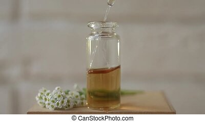 alissum essential oil in  beautiful bottle on table