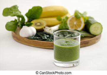 Alkaline diet - Green smoothie alkaline diet drink beside a...
