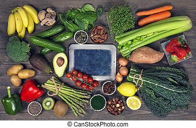 Alkaline foods above the wooden background