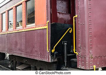 Steps onto a vintage train passenger car evoke dreams of old-time adventure travel.