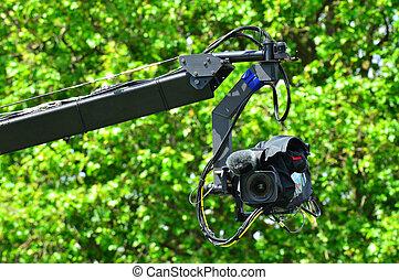 Professional video camera on JIb crane outdoors.