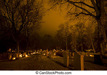 Looking across light candles on all hallows eve, in Uppsala, Sweden.