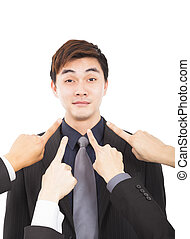 all hands pointing towards businessman