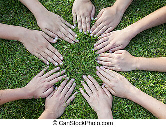 all hands together on the grass  as a team