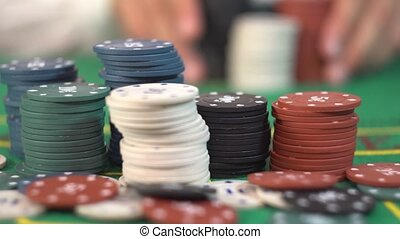 All in Betting, Stacks of Poker Chips - Poker gambler is...