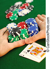 """All in - Poker player going """"all in"""" pushing his chips ..."""
