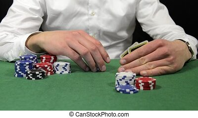 All in - Poker player with a stack of chips showing his hand...