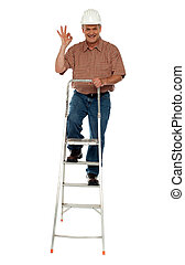 Contraction worker with excellent gesture climbing on ladder, full length portrait