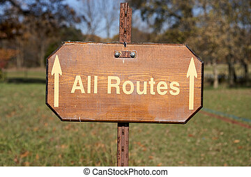 All Routes sign with forward pointing arrows