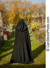 All Saints visitor - Woman with victorian cape visiting a...