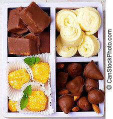 all sorts of handmade bonbons  in a box.
