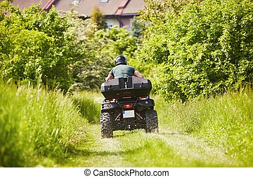 All Terrain Vehicle rider - Man in helmet is driving the all...