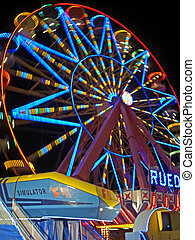 All the fun of the fair - Moving fairground wheel ful of...
