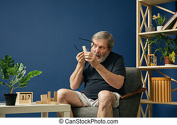 Old bearded man with alzheimer desease - All the things lose...