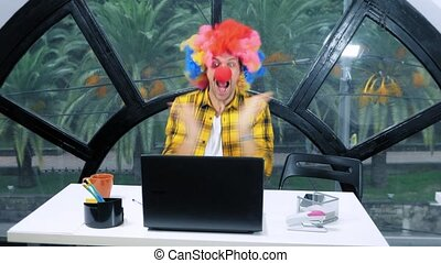 allegory concept, office worker. Clown manager in the...