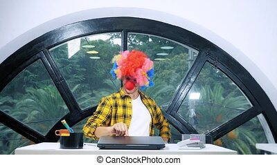 allegory concept, office worker. Clown manager in the office.