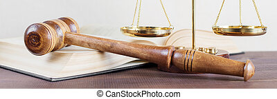 Symbols of law: wood gavel, soundblock, scales and opened volumetric old books