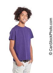 allegro, teenager., sorridente, africano, giovane, ragazzo adolescente, tenere mani, in, tasche, mentre, standing, isolato, bianco