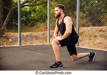 allenamento, stiramento, giovane, sportivo, fuori, durante, gambe, bello