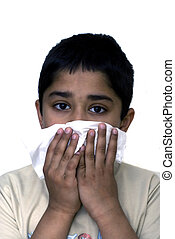 Allergy - A young handsome boy with a tissue to his nose...