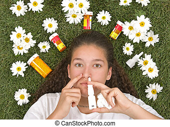 Allergy Relief - Teenage girl using nose spray for her...