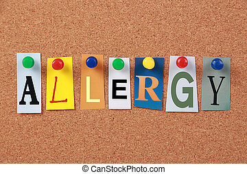 The word Allergy in cut out magazine letters pinned to a corkboard.
