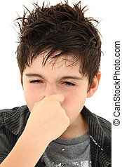 Allergy Stinky Face Expression - Adorable young boy making...
