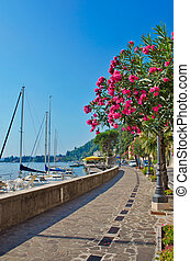Alley by the lake with yachts, Garda lake, Italy - Alley ...