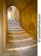 Stone steps in a remote alley in the picturesque medieval town of Sorano, Grosseto, Tuscany, Italy