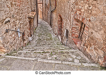 alley in the old village Castiglione d'Orcia, Siena, Tuscany, Italy