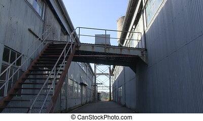 Alley of a warehouse shot - A medium shot of an alley of a...