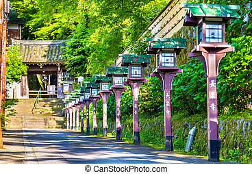 Alley of wooden lanterns at Chorakuji Temple in Kyoto, Japan