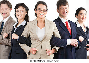 Alliance - Photo of five business partners holding each...