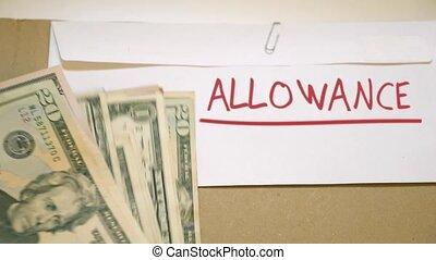 ALLOWANCE cash concept - USD bills on ALLOWANCE cash...