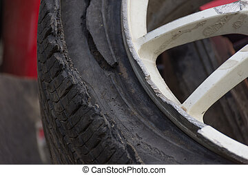 Alloy wheels of car damaged from accident ,close-up