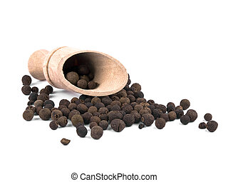 Whole allspice berries and wooden shovel on white background