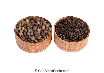 allspice in a wooden bowl. Black pepper. isolated on white background.