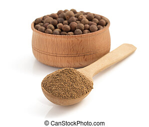 allspice in spoon on white background