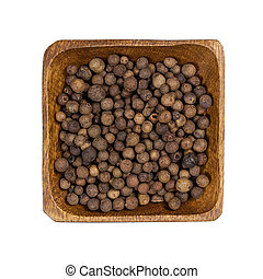 Allspice in wooden bowl isolated on white