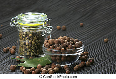 allspice on a black background