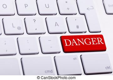Alluminium keyboard with DANGER word written on red button