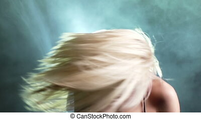 Allure - Close-up of an alluring blonde tossing her hair in...